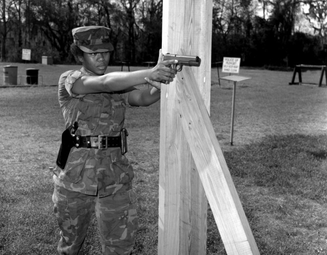 LT. CPL. A. J. Nesbit, a military policewoman, practices firing the Colt .45-caliber pistol at the police protective course. The course is a part of a 200-hour training program for the base military police. She is using a standing post position (unofficial)