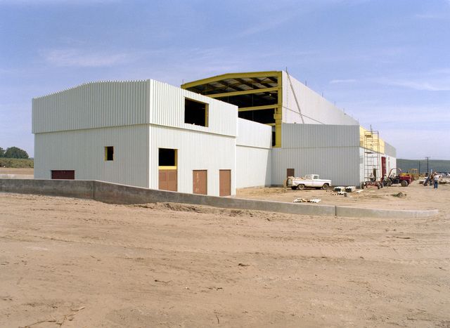 An exterior view of the east wall and high bay of the Missile X (MX) advanced intercontinental ballistic missile mechanical maintenance facility