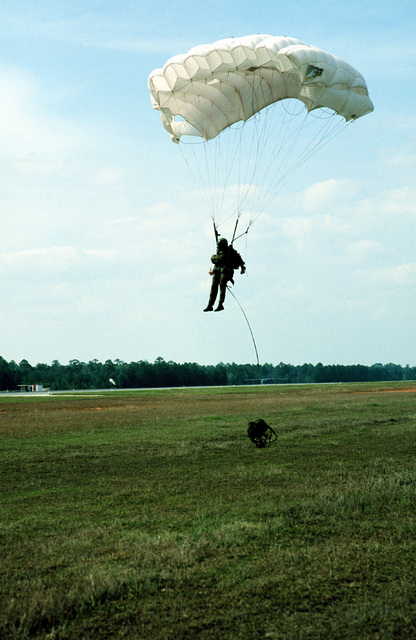 A Combat Control Team member from the 1ST Special Operations Wing, descends to the ground by HALO (High Altitude Low Opening) parachute