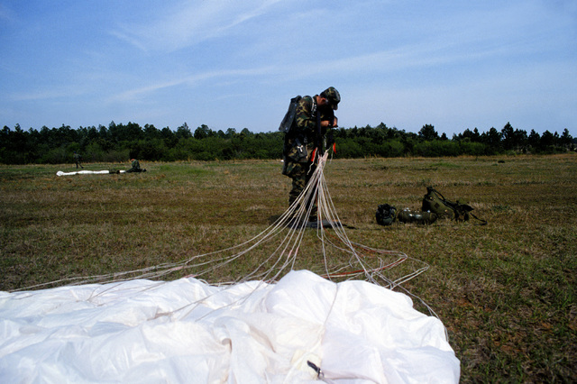 A Combat Control Team member from the 1ST Special Operations Wing just after landing in a high altitude low opening (HALO) parachute
