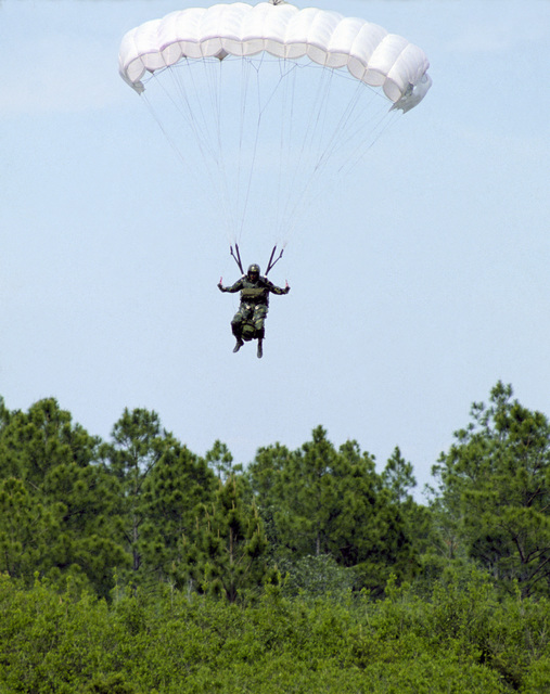 A Combat Control Team member from the First Special Operations Wing, descends to the ground by HALO (High Altitude Low Opening) parachute