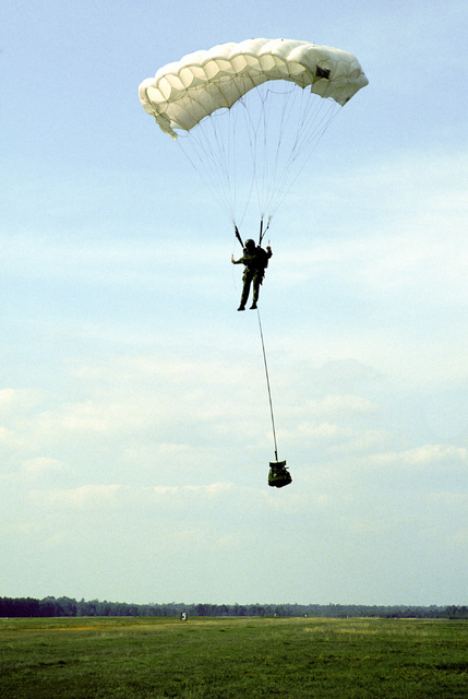 A Combat Control Team member from the First Special Operations Wing descends to the ground by HALO (High Altitude Low Opening) parachute