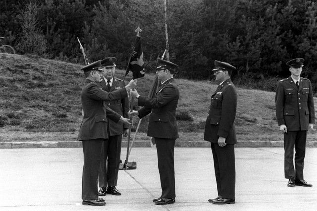 A unit flag is being transferred from BGEN Jerry W. Tietge, left, to COL Edward P. Merkle at the change of command ceremony. Merkle assumes the command of the 86th Tactical Fighter Wing from BGEN Tietge