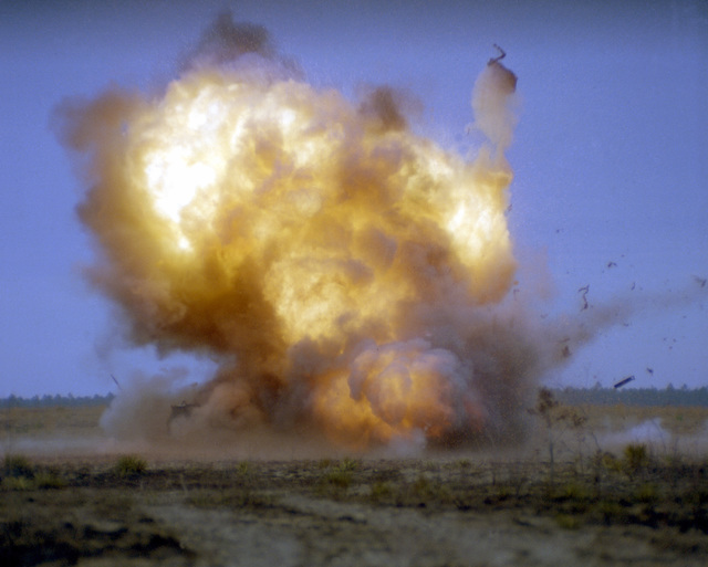 A view of the explosion caused by an AGM-65 Maverick missile destroying a target tank, part of a fuse delay warhead evaluation taking place during an alternate warhead test