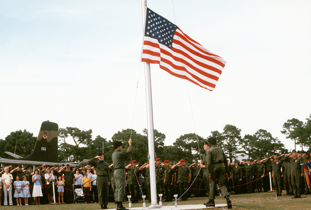The 1ST Special Operations Wing presents a memorial service for the eight servicemen, including its five members, who were killed in the attempt to rescue the American hostages held in Iran on April 24, 1980. Members of the security police lower a U.S. flag to half mast to begin the ceremony