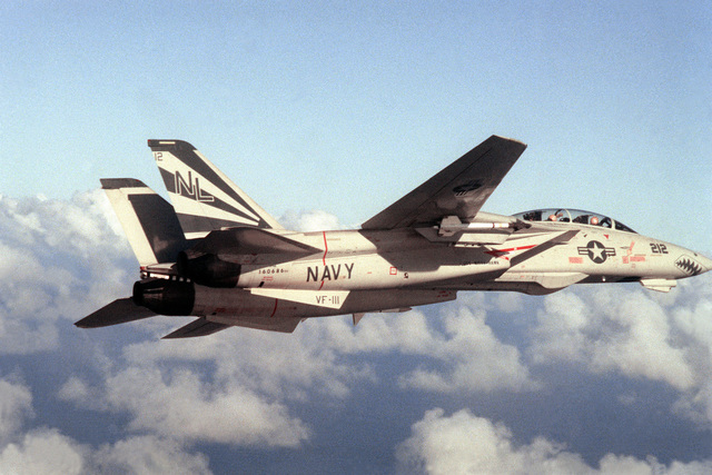 An air-to-air right side view of an F-14A Tomcat aircraft from Fighter Squadron 111 (VF-111)
