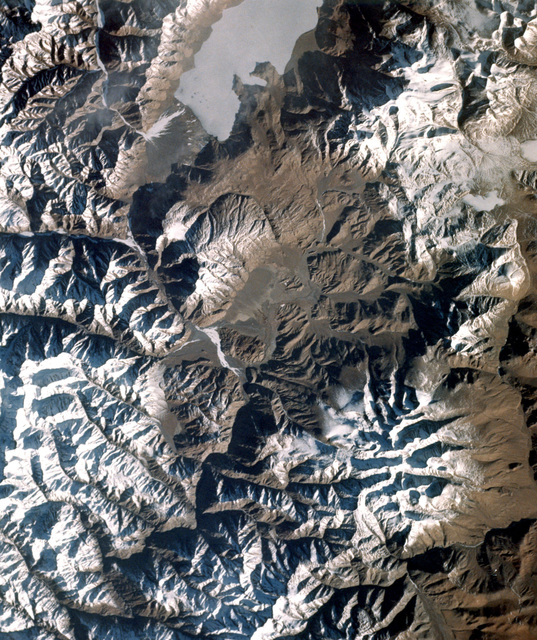Space photo of the Himalaya Mountains, in parts of India and China. The photo was taken from the space shuttle orbiter Columbia during the first space transportation system test mission