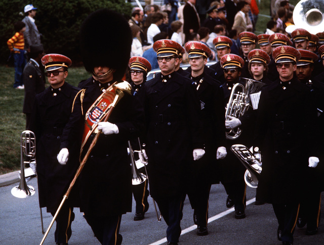 A military band marches out of the cemetery after the funeral of GEN Omar Bradley