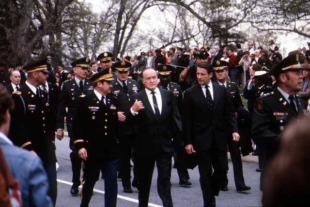 Bob Hope and joint-service officers leave the cemetery after the funeral of GEN Omar Bradley