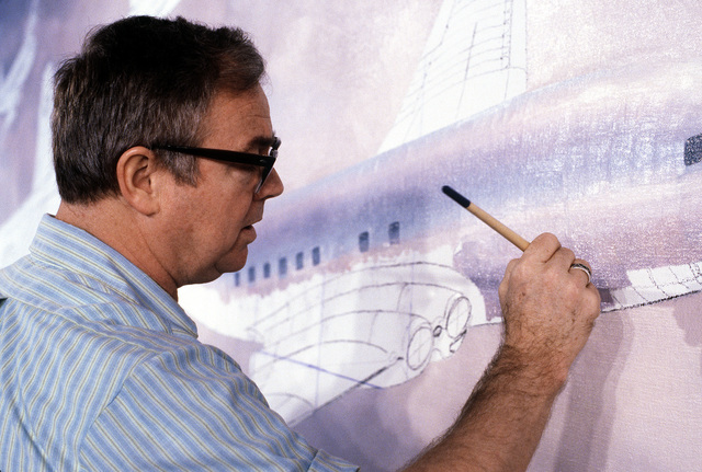Keith Ferris, an aviation artist, paints a mural picture of in-flight aircraft at the jet aviation gallery, National Air and Space Museum