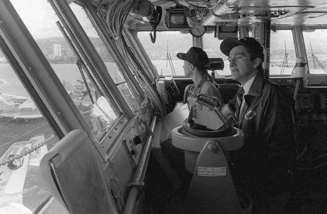 Secretary of the Navy John F. Lehman Jr. and his wife visit the bridge of the aircraft carrier USS KITTY HAWK (CV-63)
