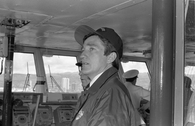 Secretary of the Navy John F. Lehman Jr., visits the bridge of the aircraft carrier USS KITTY HAWK (CV-63)