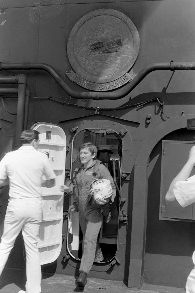 Secretary of the Navy John F  Lehman Jr , wearing flight gear, steps