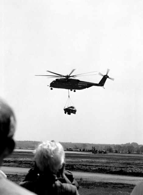 A Marine Corps CH-53E Super Stallion helicopter lifts a Canadian armored vehicle, general purpose (AVGP), Cougar, with ease. The vehicle can be fielded under 14 tons