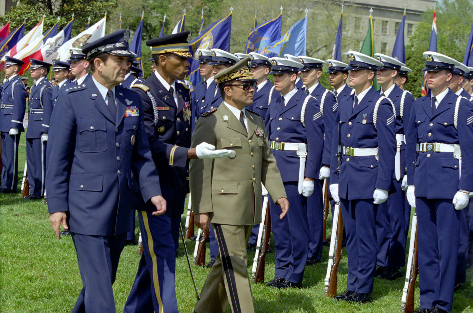 U.S. Air Force GEN. David C. Jones (front left), Chairman of the Joint Chiefs of STAFF and ceremony host, U.S. Army COL. Don Phillips (front center), Commander, 3rd Infantry Division, and Republic of Tunisia Army MAJ. GEN. Abdel Hamid Ben Mohamed Escheikh (front right), CHIEF of STAFF, Tunisian Army, review the troops during the Armed Forces Full Honors Arrival Ceremony for MAJ. GEN. Escheikh, conducted outside the Pentagon on April 20, 1981.  OSD Package No. A07D-00372 (DOD PHOTO by Robert D. Ward) (Released)