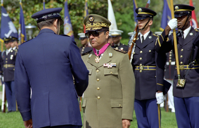 U.S. Air Force GEN. David C. Jones (left), Chairman of the Joint Chiefs of STAFF and ceremony host, shakes hands with Republic of Tunisia Army MAJ. GEN. Abdel Hamid Ben Mohamed Escheikh (second from left), CHIEF of STAFF, Tunisian Army, after awarding him the Legion of Merit, during the Armed Forces Full Honors Arrival Ceremony conducted in his honor outside the Pentagon on April 20, 1981.  OSD Package No. A07D-00372 (DOD PHOTO by Robert D. Ward) (Released)