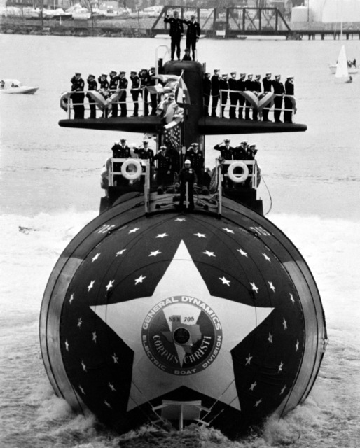 A bow view of the nuclear-powered attack submarine CITY OF CORPUS CHRISTI (SSN-705) sliding down the ways at the conclusion of the launching ceremony