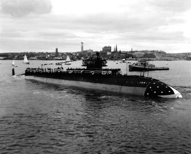 A starboard bow view of the nuclear-powered attack submarine CITY OF CORPUS CHRISTI (SSN-705) in the water at the conclusion of the launching ceremony