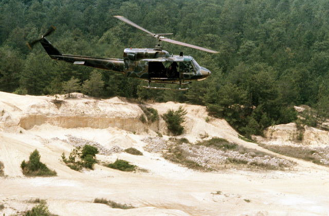 A view of an UH-1N Iroquois helicopter in flight during maneuver training. The helicopter is assigned to the 20th Special Operations Squadron, 1ST Special Operations Wing