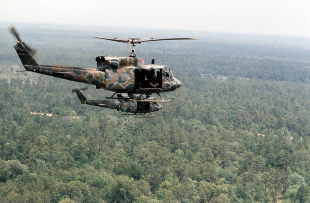 A view of two UH-1N Iroquois helicopters in flight during maneuver training. The helicopters are assigned to the 20th Special Operations Squadron, 1ST Special Operations Wing