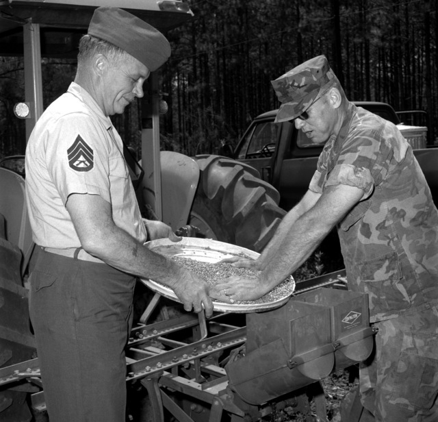 GYSGT C.W. Simpson and SSGT E.M. Curtis prepare a food plot for the wild game at the Indian Lake Wildlife Refuge that is located on the base. Simpson is the base game warden