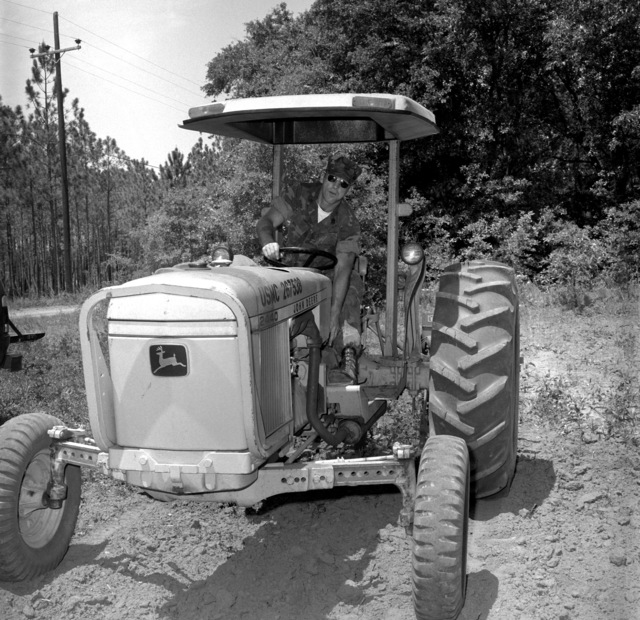 GYSGT C.W. Simpson, base game warden for the Indian Lake Wildlife Refuge, plants a food plot by using a tractor. The refuge is located on the Marine Base