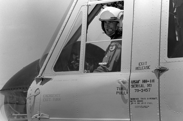 LT Kim F.P. Skrinak is aboard an HH-1H Iroquois helicopter before take-off. The lieutenant is one of two pilots, who will be presented the Cheney Awards of 1980 for rescuing a crash-injured glider pilot in a mountain on 24 January 1980