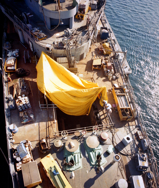 A vertical view of the forward deck of the guided missile ship USS NORTON SOUND (AVM-1) with a hole made for installation of the vertical launching system (VLS) at the Ingalls Shipbuilding Co