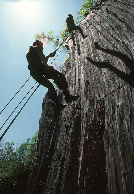 Infantrymen rappel down a cliff during a training exercise