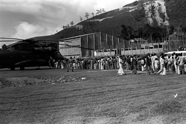 Hundreds of people stand in line to get a look at the CH-53 Sea Stallion helicopter that was put on display after the airlift of television parts for the Sri Lankan television station. The Marines and the helicopters are from Marine Medium Helicopter Squadron 165 (HMM-165)