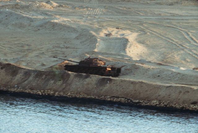 A view of a Soviet T-64 medium tank on the edge of the canal during the transit of the USS AMERICA (CV 66) Task Group. The tank was destroyed in 1973 during the conflict between Israel and Egypt
