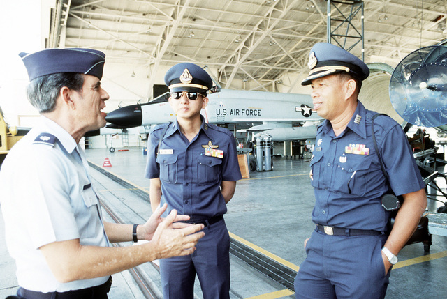 LTC Ron Silva of the Hawaii Air National Guard, left, talks with tow Thai officers during a joint exercise
