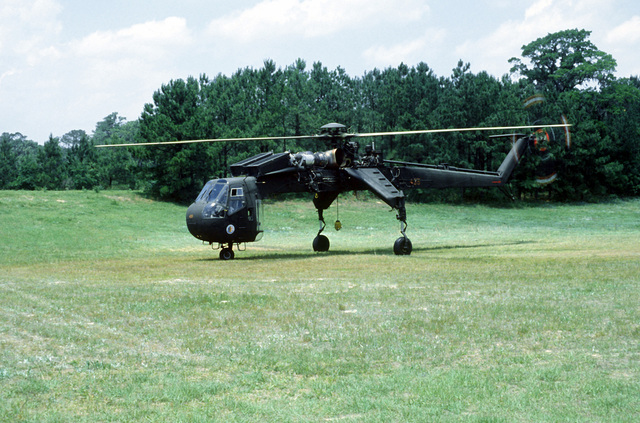 Left front view of a CH-54 Skycrane helicopter prior to take off, for the pick up of a C-141 Starlifter aircraft fuselage (not visible)