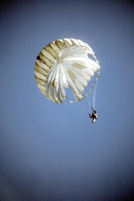 A cadet parachutes during training