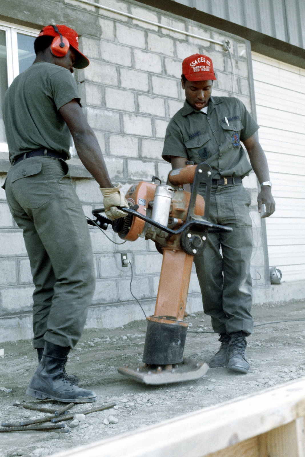 Two members of the 554th Civilian Engineering Squadron (Red Horse), at work during construction of the new commissary