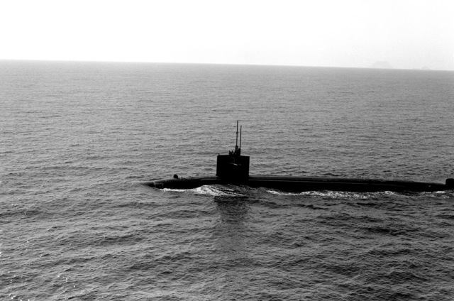 A port beam view of a nuclear-powered submarine underway