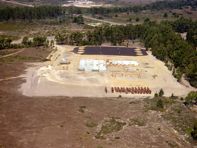 An aerial view of the integrated test facility construction progress at the Missile X (MX) advanced intercontinental ballistic missile site, looking west