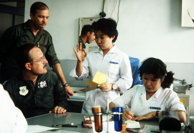 MAJ John Kalosis, a flight surgeon from the hospital at Yokota Air Base and TSGT John Long from Langley Air Force Base, Virginia, work with their Japanese counterparts during Exercise Cope North '81-3