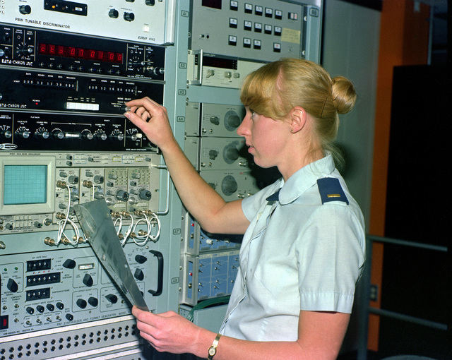 Second LT. Louise Demers, a mathematician at Headquarters, Foreign Technology Division, Directorate of Sensor Data, adjusts electronic test equipment