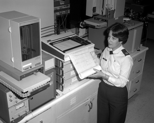 CAPT. Victoria Dunovant, a quality assurance officer at the Occupational and Environmental Lab, checks the printout from a gas chromatograph