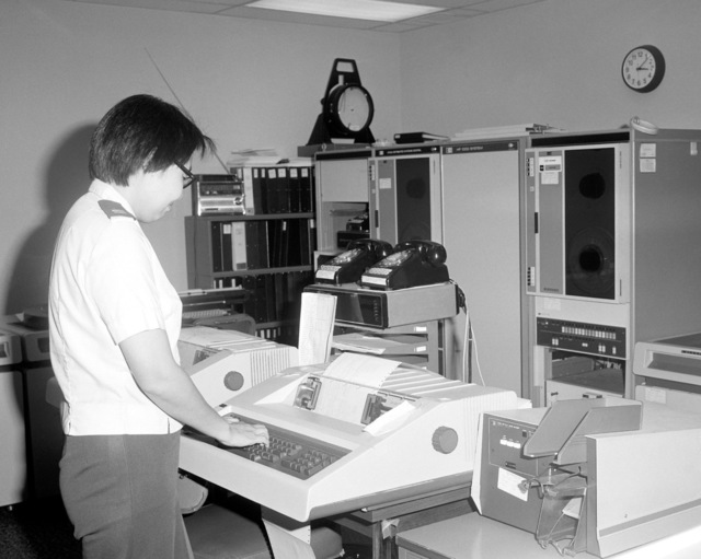 Captain Sally Wu operates a data processing terminal at the Occupational and Environmental Health Lab