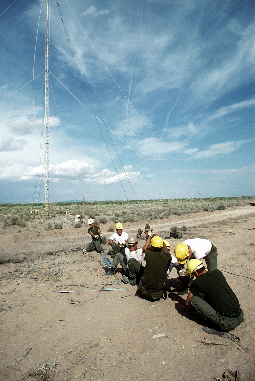 Members of the 3rd Combat Communications Group erect an OE-85 log