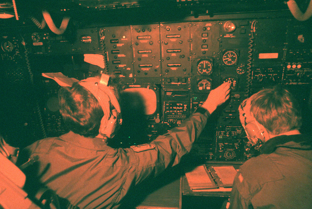 Navigators work in their station aboard a B-52H Stratofortress aircraft in flight during exercise Busy Prairie II