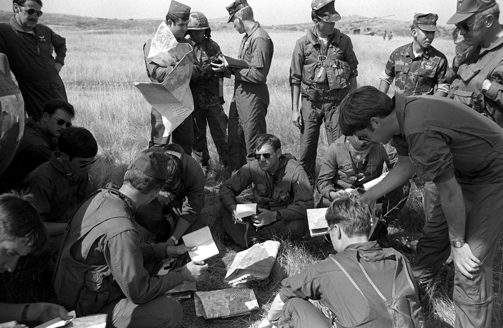 Army helicopter pilots and Marine infantry officers take notes during a briefing prior to an assault on combat town. Marines from Co. F, 2nd Bn., 1ST Marines, are taking part in the field exercise