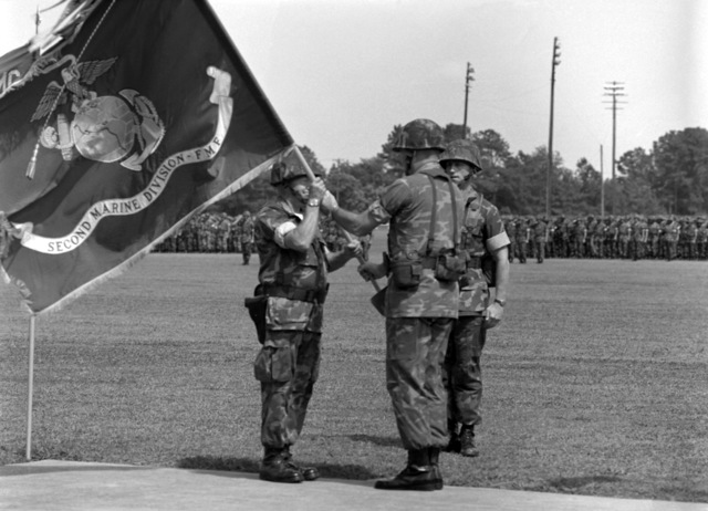 MGEN Alfred M. Gray Jr., new commanding general, 2nd Marine Division, receives the division colors from MGEN David M. Twomey, right, outgoing commanding general, 2nd Marine Division. BGEN Joseph E. Hopkins, assistant commanding general, 2nd Marine Division , is in the background