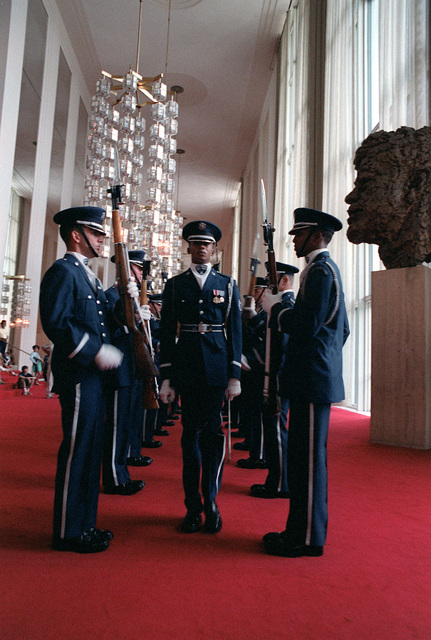 The U.S. Air Force Presidential Honor Guard Drill Team in formation inside the John F. Kennedy Center for the Performing Arts