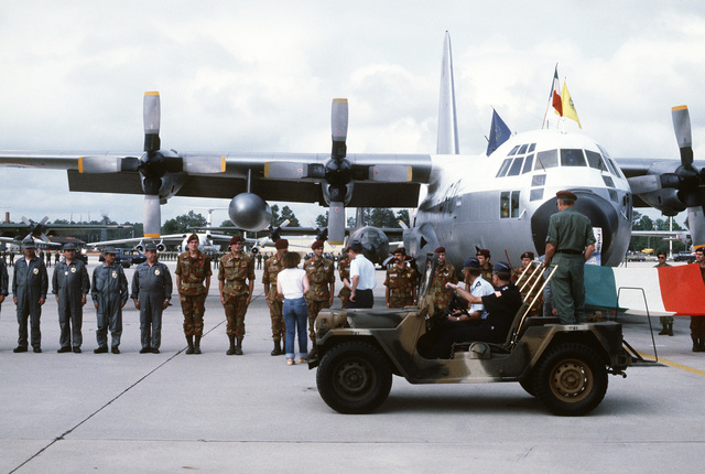 A row of Royal Canadian Air Force members, standing in front of their C-130 Hercules aircraft, are inspected during the opening ceremony for the Volant Rodeo 1981 competition