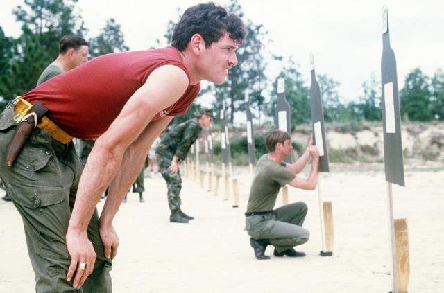 A Royal Canadian Air Force member checks his target for accuracy at the firing range during the Volant Rodeo 1981 competition