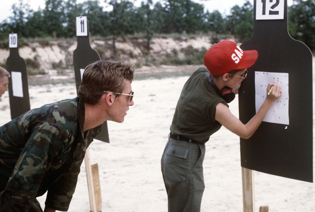 A Royal Canadian Air Force member watches the judge check his target for his score on the firing range during the Volant Rodeo 1981 competition