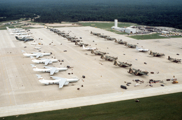 Aerial view of rows of parked aircraft, on the flight line, being used during the Volant Rodeo 1981 competition